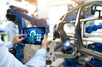 Embedded Software Development Services - Image Of A Handheld Being Used In A Car factory