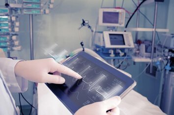 Embedded Software Development Services - Image Of A Handheld Device In a Medical Environment